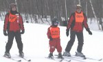 Blind skier with guides